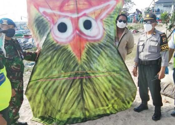 Nusabali.com - bahayakan-penerbangan-polisi-turunkan-layangan