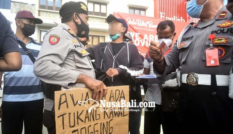 www.nusabali.com-bawa-pamflet-awas-ada-tukang-kawal-jogging-pelajar-dicegat-polisi