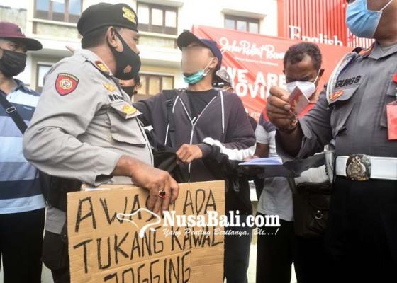 Nusabali.com - bawa-pamflet-awas-ada-tukang-kawal-jogging-pelajar-dicegat-polisi