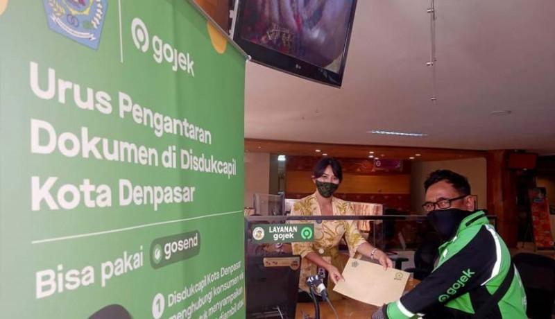 www.nusabali.com-disdukcapil-mudahkan-warga-denpasar-lewat-layanan-gojek