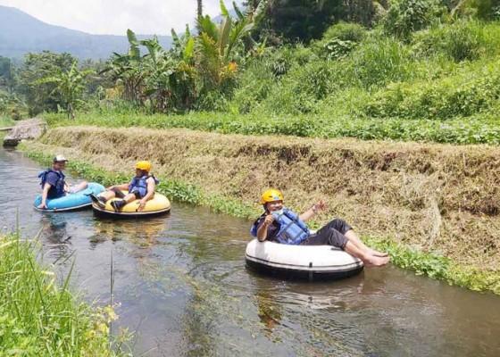 Nusabali.com - desa-babahan-kembangkan-wisata-tubing-dengan-panjang-rute-900-meter