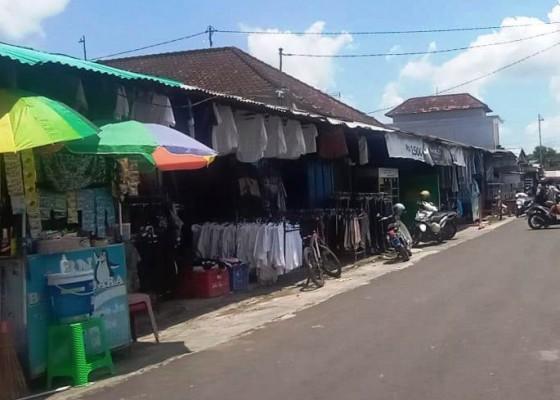 Nusabali.com - pandemi-pasar-kodok-sepi-pembeli