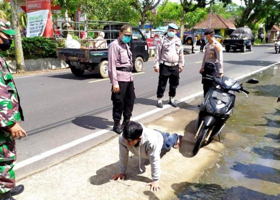 Nusabali.com - tabanan-tambah-7-kasus-tni-ikut-tegakkan-prokes
