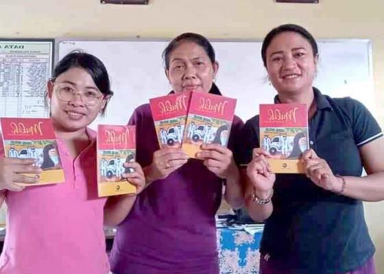 Nusabali.com - guru-smkn-abang-terbitkan-mulih