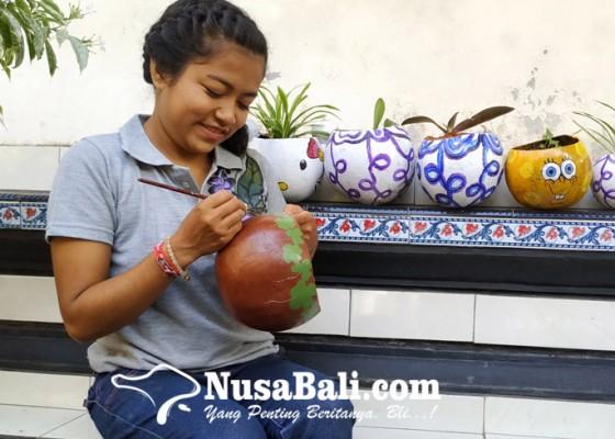 Nusabali.com - sulap-buah-maja-menjadi-pot-tanaman-bernilai-ekonomis