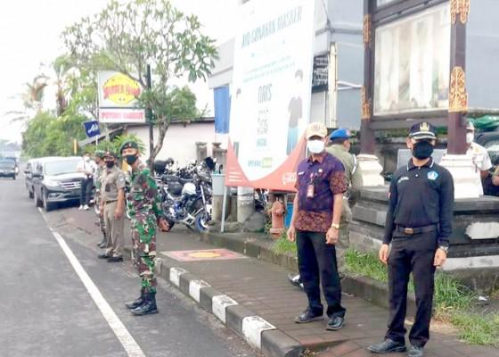 Nusabali.com - langgar-prokes-seorang-warga-di-pasar-petang-didenda-rp-100-ribu