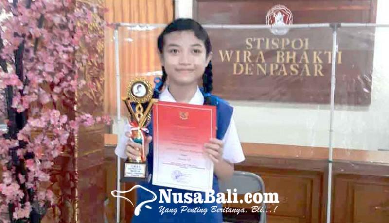 www.nusabali.com-siswi-smpn-2-amlapura-juara-artikel-di-stispol