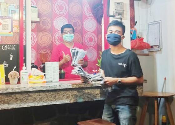 Nusabali.com - kmhdi-bagikan-masker-ke-pelaku-usaha