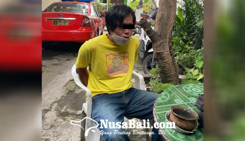 www.nusabali.com-pamer-burung-pemuda-misterius-dihajar-warga