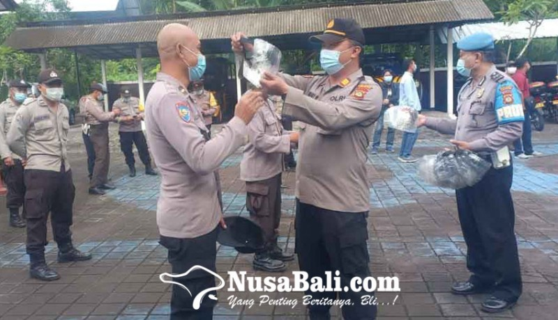 www.nusabali.com-polsek-abang-bagikan-face-shield