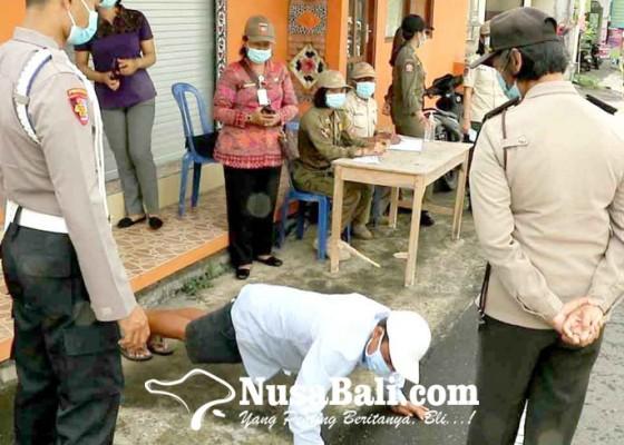 Nusabali.com - pelanggar-prokes-covid-19-dihukum-push-up