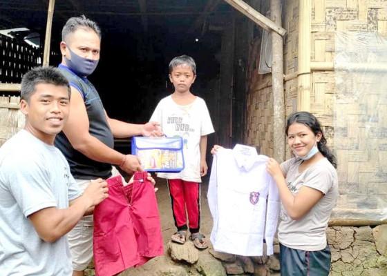 Nusabali.com - rayakan-hut-ke-3-komunitas-balawa-bagikan-sembako-dan-seragam