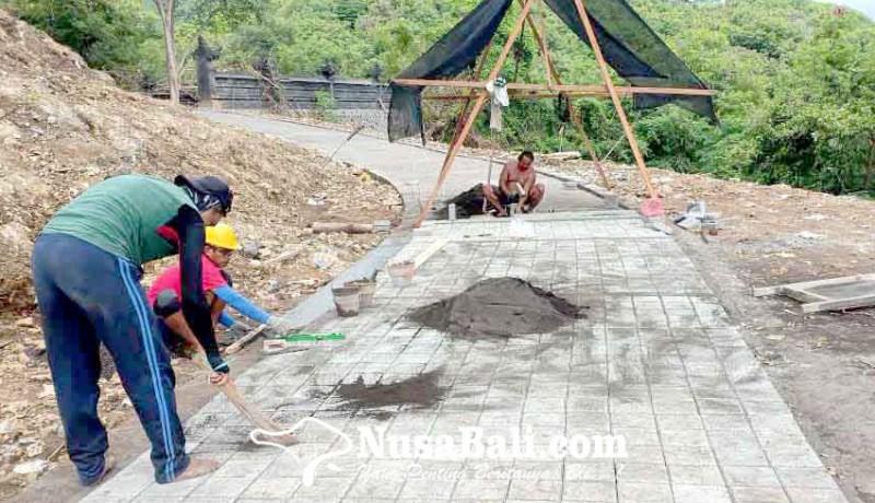 www.nusabali.com-desa-padangbai-rampungkan-jalan-lingkar-pura-silayukti
