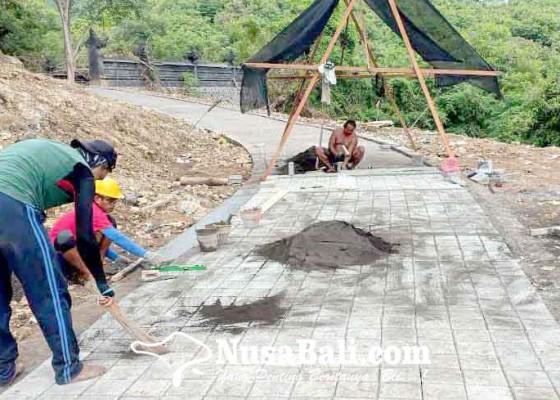 Nusabali.com - desa-padangbai-rampungkan-jalan-lingkar-pura-silayukti