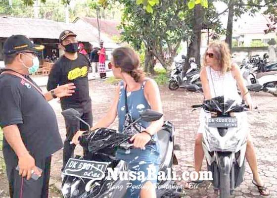 Nusabali.com - delapan-wisatawan-terjaring-tanpa-masker-yang-benar