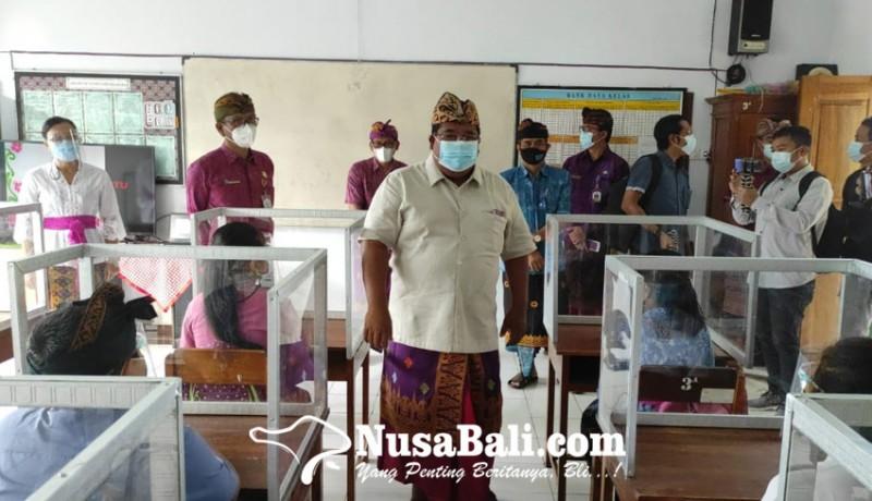 www.nusabali.com-wajibkan-ganti-masker-sebelum-masuk-areal-sekolah
