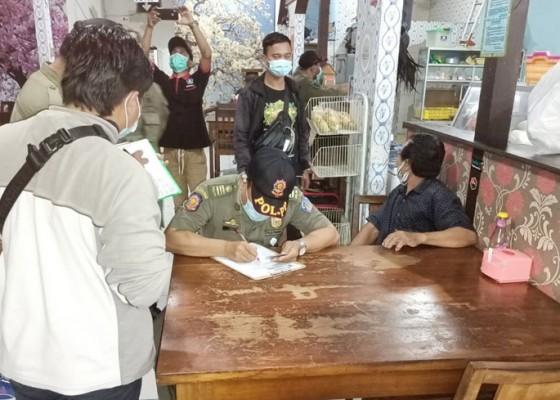 Nusabali.com - lewat-batas-jam-operasional-sejumlah-warung-makan-kena-sanksi