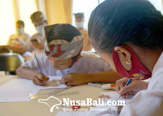 Nusabali.com - desa-purwakerti-dan-desa-adat-tukad-besi-gelar-lomba-nyurat-aksara-bali