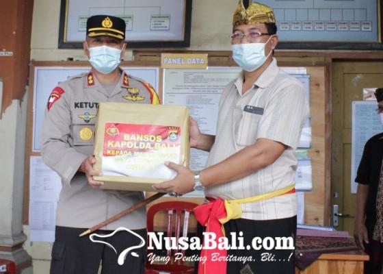 Nusabali.com - kapolda-bali-gelontorkan-99-paket-sembako