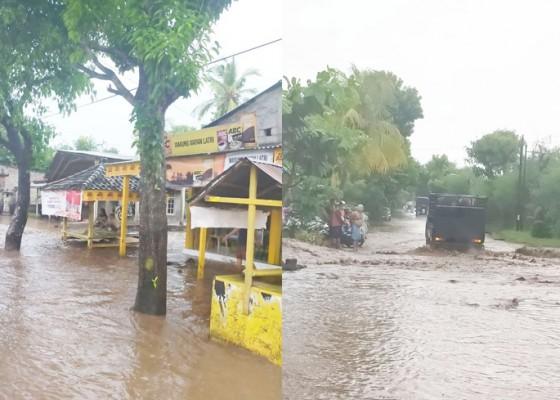 Nusabali.com - banjir-di-gerokgak-rendam-jalan-dan-pemukiman