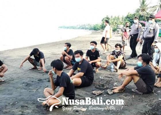 Nusabali.com - ngembak-gni-warga-serbu-pantai