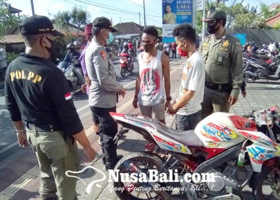 Nusabali.com - tim-yustisi-denpasar-jaring-24-pelanggar-prokes