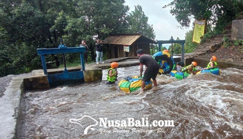 www.nusabali.com-saluran-irigasi-di-ambengan-disulap-jadi-wisata-river-tubing