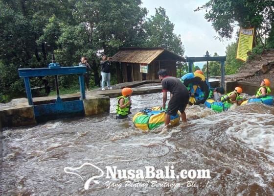 Nusabali.com - saluran-irigasi-di-ambengan-disulap-jadi-wisata-river-tubing