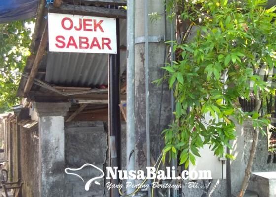 Nusabali.com - ojek-pangkalan-denpasar-mencoba-bertahan-di-tengah-desakan-ojek-online