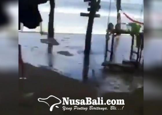 Nusabali.com - gelombang-tinggi-air-laut-meluber-ke-jalan