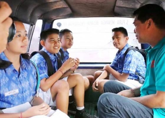 Nusabali.com - pandemi-angkutan-siswa-gratis-tak-operasi