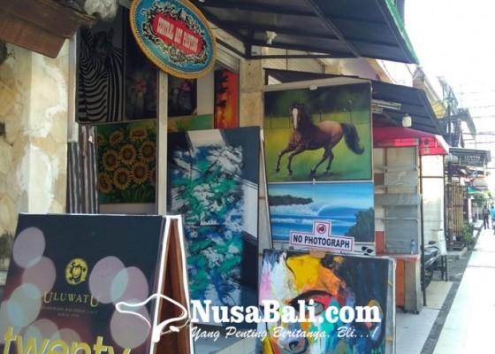 Nusabali.com - kuta-bak-kota-mati-segelintir-toko-kerajinan-nekat-tetap-buka