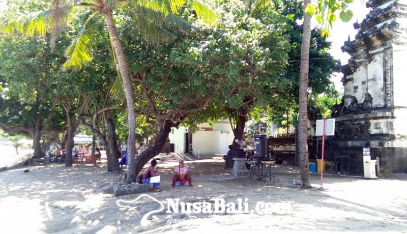www.nusabali.com-ombak-pantai-kuta-meluber-pedagang-dan-wisatawan-waspada