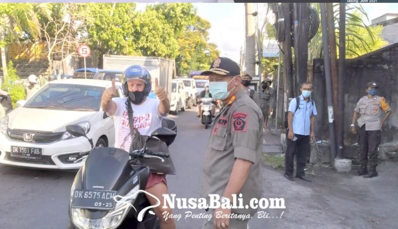 www.nusabali.com-tim-yustisi-jaring-40-orang-pelanggar-prokes