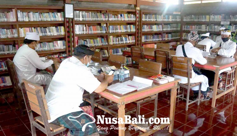 www.nusabali.com-pengadaan-buku-perpustakaan-pura-besakih-kena-refocusing