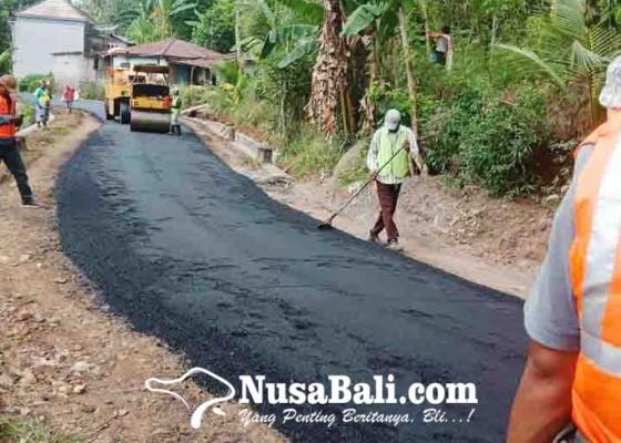 Nusabali.com - belasan-km-jalan-dihotmix-tahun-ini