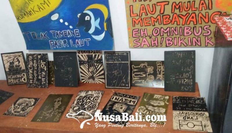 www.nusabali.com-walhi-bali-suarakan-isu-lingkungan-melalui-seni-cukil