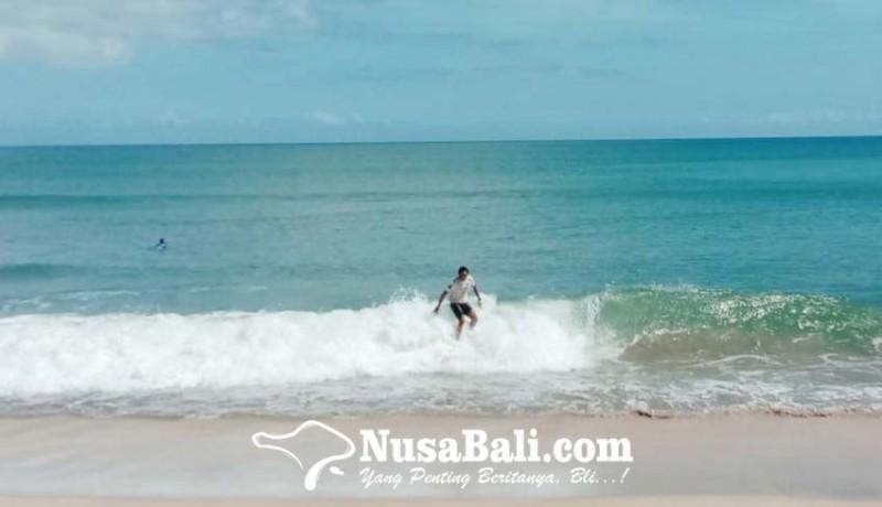 www.nusabali.com-puluhan-surfer-hidupkan-pantai-kuta