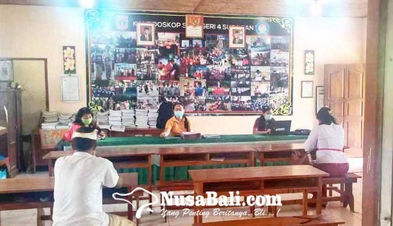 www.nusabali.com-sdn-4-subagan-kebanjiran-siswa