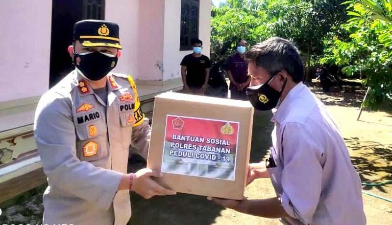 www.nusabali.com-polres-tabanan-bagikan-sembako-kepada-35-warga-isolasi-mandiri