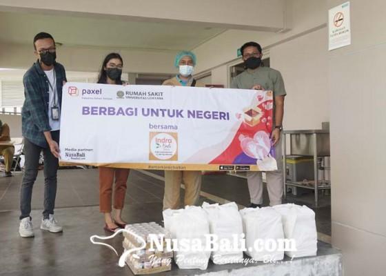 Nusabali.com - antarkan-kebaikan-paxel-bali-kirim-paket-makanan-untuk-tenaga-kesehatan-rs-unud
