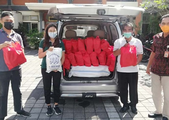 Nusabali.com - isoman-pemkot-salurkan-5018-paket-sembako