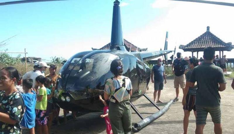 www.nusabali.com-heli-mendarat-darurat-di-objek-wisata-tirta-amed