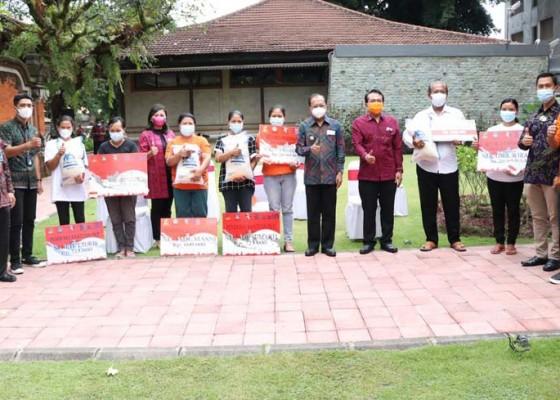 Nusabali.com - koster-salurkan-bantuan-sosial-untuk-masyarakat-bali
