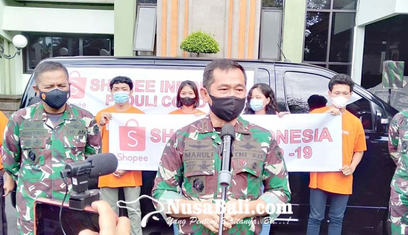 www.nusabali.com-kodam-udayana-salurkan-50-ton-beras-untuk-masyarakat-pinggir-jalan