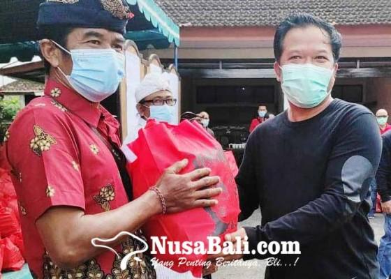 Nusabali.com - bupati-sedana-arta-salurkan-7000-paket-sembako