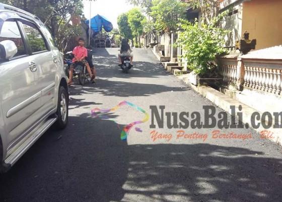 Nusabali.com - tahun-2017-65-kilometer-jalan-siap-diaspal